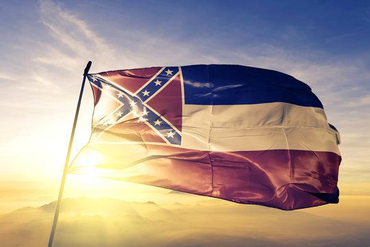Mississippi state of United States flag waving on the top sunrise mist fog