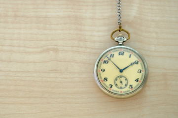 mechanical hand watch on wooden background