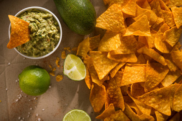 Golden tortilla chips with guacamole