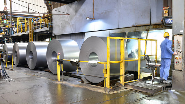 industrial plant for the production of sheet metal in a steel mill