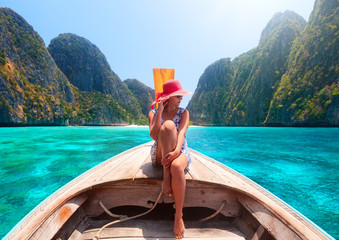 woman traveling by boat in summer vacation among the islands Phi Phi and Maya beach in Thailand.