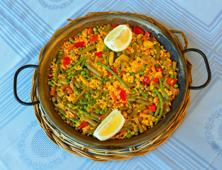 Vegan paella with rice and some vegetables.