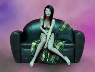 Junge Frau in sexy Dessous auf einer Couch