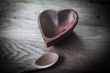 wooden salad bowl in the shape of a heart and spoon