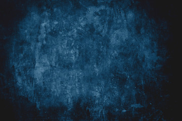 dark blue grungy wall background or texture
