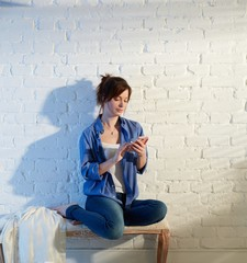 Young woman using mobile