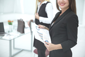 close up. business woman with financial report