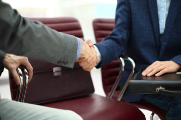close up.handshake of two business in the office lobby