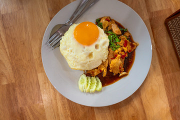 Rice topped with stir-fried chicken  and fried egg Thailand food.