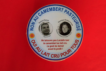 A box of a non-pasteurized French Camembert cheese with the pictures of French deputy Richard Ramos and Veronique Richez-Lerouge president of Fromages de Terroirs is seen at the National Assembly in Paris