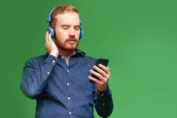 Man enjoying music via mobile app