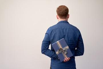 Man hiding present