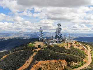 Aerial view of telecommunication antennas on the top of Black Mountain in Carmel Valley, SD, California, USA.  Television, radio and communications antenna with numerous transmitters, Technology.