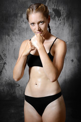 Beautiful fit slim woman trains boxing and martial arts for self defense