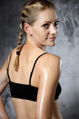 Portrait of a sporty slim woman with fit and athletic body after training and workout