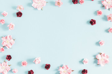 Flowers composition creative. Purple and pink flowers on pastel blue background. Flat lay, top view, copy space