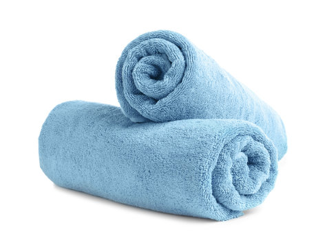 Rolled soft terry towels on white background