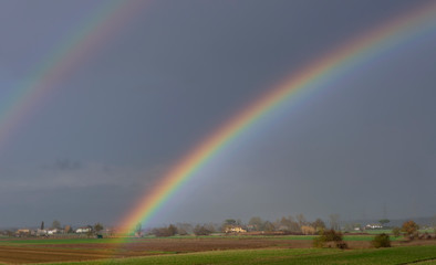 Beautiful rainbow over the countryside of the province of Pisa, Tuscany, Italy, Europe