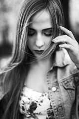 Black and white portrait of beautiful sensual blonde woman with make up posing outdoors. Close up