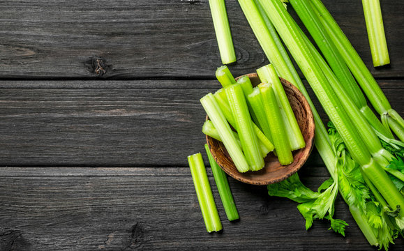 Pieces of celery in a wooden bowl.