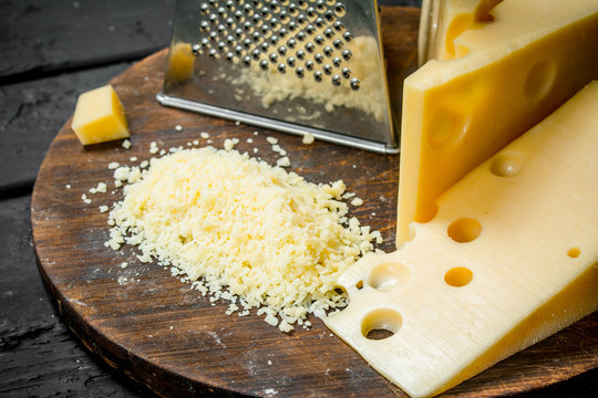 Grated cheese on a wooden Board.