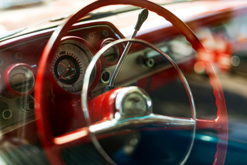 Steering wheel view of a Red colored 1957 Chevrolet. Wall mural