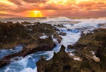 Wall Mural - Ocean crashing over rocks in Oahu