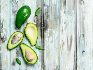 A whole avocado, and avocado slices.