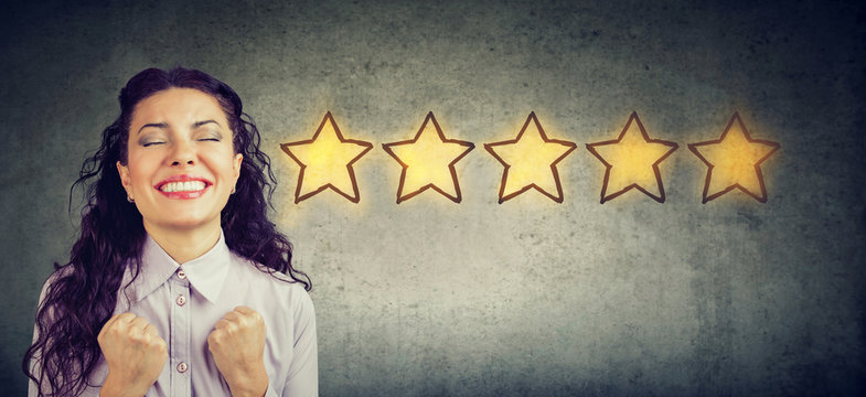 Сheerful beautiful woman smiling celebrating five stars rating for service provided.