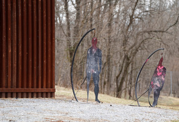 Silhouettes used for target practice stand next to a simulated border wall at the U.S. Customs and Border Protection Advanced Training Facility in Harpers Ferry, West Virginia