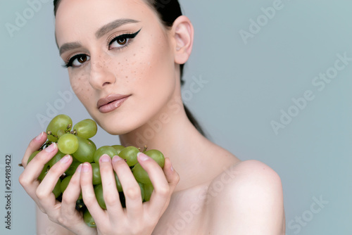 Portrait Of Young Woman With Grapes Stock Photo And Royalty