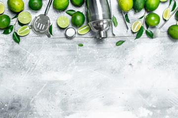 Shaker and fresh juicy lime.