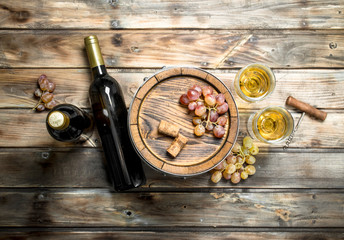 Wine background. White wine in an old barrel.