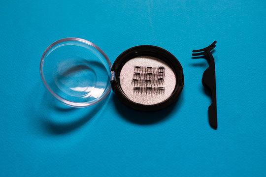 Artificial Magnetic False Eyelashes Tool on blue background