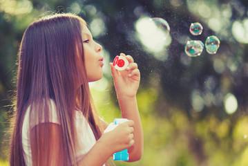 Printed kitchen splashbacks Artist KB Young female child blowing soap bubbles