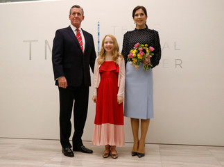 Danish Crown Princess Mary poses for a photo with Texas Medical Center's CEO William McKeon and Emma Iversen upon arriving at the launch of Danish-Texan Bio-bridge within Life Science event at the Texas Medical Center in Houston, Texas