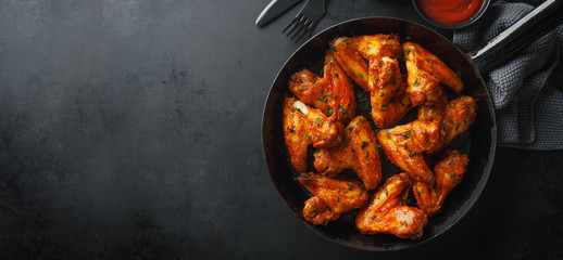 Canvas Prints Hot chili peppers Chicken wings grilled in sauce on pan
