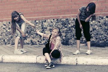 Group of happy teen girls on city street