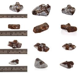 macro mineral stone Staurolite on a white background