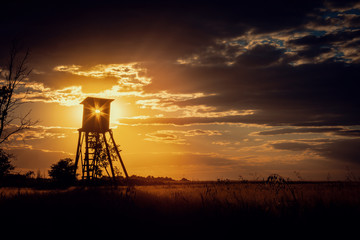 Dark Sunset Landscape with Sun in Hunting Tower Wall mural