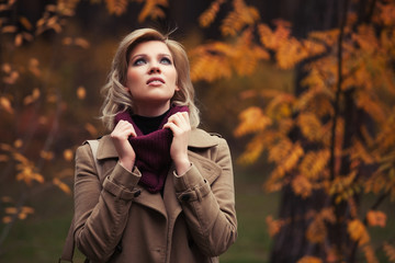 Young fashion woman walking in autumn park