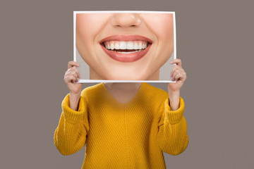 concept of emotions. A woman with a charming smile and beautiful teeth. Dentistry