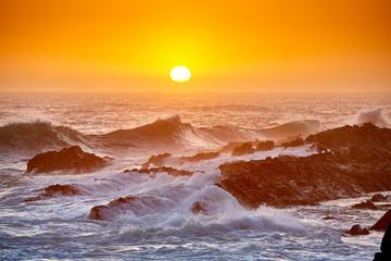 High waves at beautiful sunset