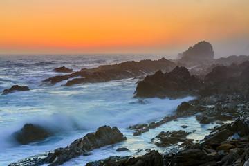 Rocky coast after sunset