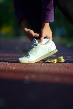 Woman runner hold her sports injured leg. Sports injuries to women with joint ankle pain. Healthcare and sport concept.
