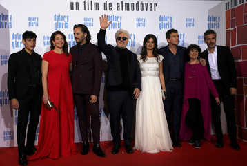 "Spanish director Pedro Almodovar waves along cast members during the premiere of their latest film ""Pain and Glory"" in Madrid"
