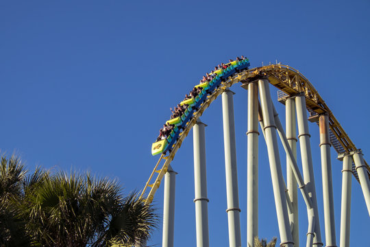 Rollercoaster dropping down at amusement park