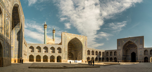 Panoramic view of Shah Abbas Mosque, unesco heritage site, inside courtyard with iwans, Esfahan, Iran