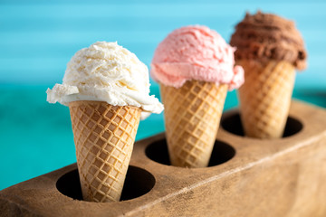Wall Mural - A Line of Three Classic Flavors of Ice Cream in a Wooden Sugar Mold