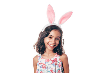 Studio shot of a happy little girl wearing bunny ears. Happy Easter
